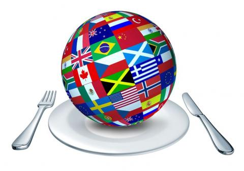 Globe with flags on plate